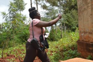 Ruth, one of the trainees, taking a photo of a point.