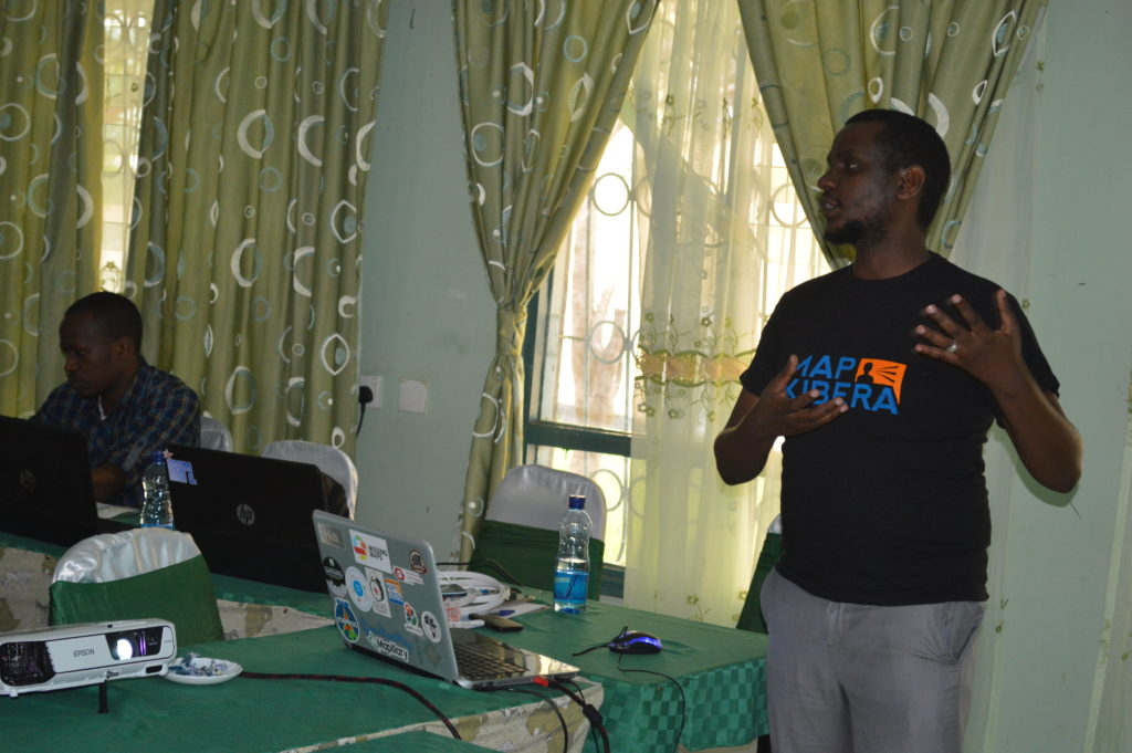 Zack Wambua from Map Kibera introducing the team to mapping using OpenStreetMap